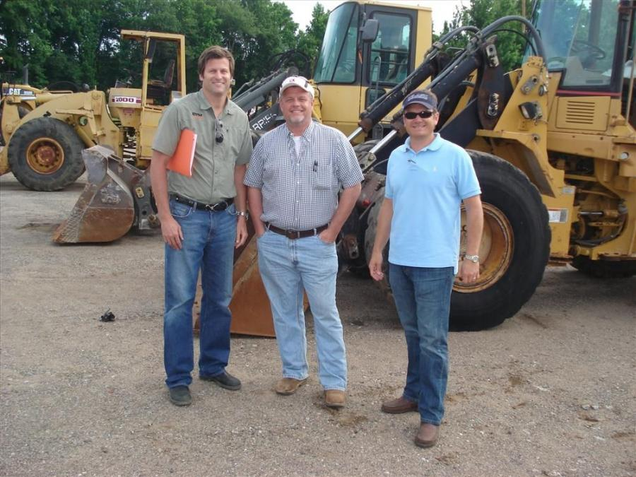 (L-R): Clay Thornton, Brent Beverly and Stuart Kay, all of BTM Machinery in Charleston, S.C., check on the machines they had up for auction and shop for other machines.