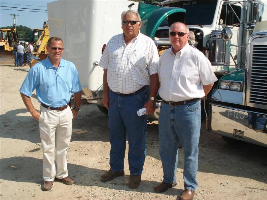 Nelson Holland (L), and Jack Branson (R), Liebherr; talk with Rick Sowers, Sowers Construction Company, Mt. Airy, N.C.  Sowers is working on several unique projects and likes to know about the latest equipment offerings.