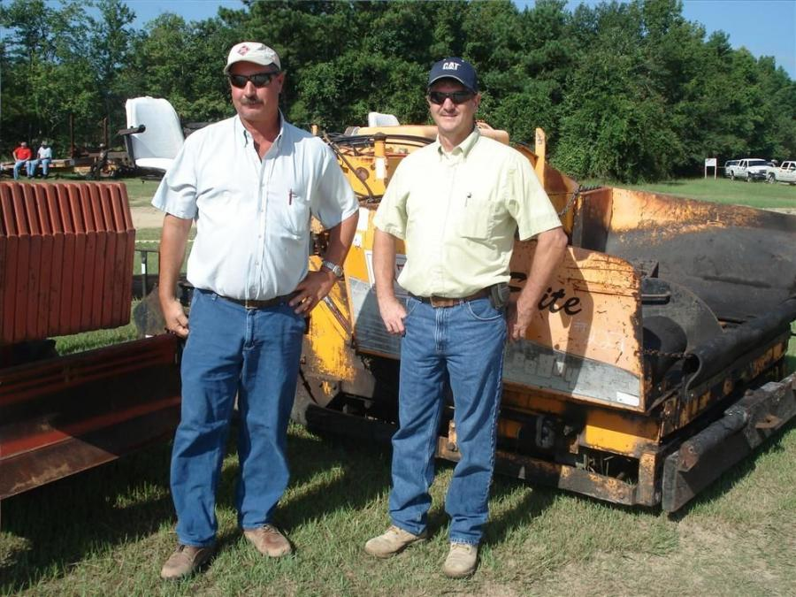 Arnold Sandy (L) and Craig Byrd, both of Sandy Hauling & Backhoe Service in Roseboro, N.C., were in the market to buy a few excavators and were thinking about getting into the paving business by buying this LeeBoy 8500 paver.