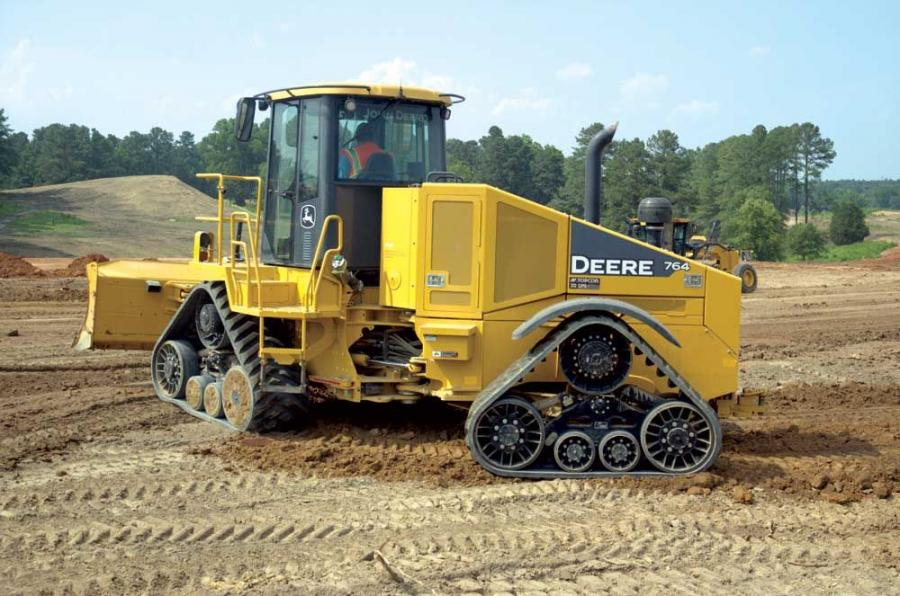 Customers at RW Moore Equipment Company's June demonstrations saw the John Deere 764 high-speed dozer in action. The dozer is rated at 200 net hp (270 kW) and weighs 32,000 lbs. (14,515 kg).