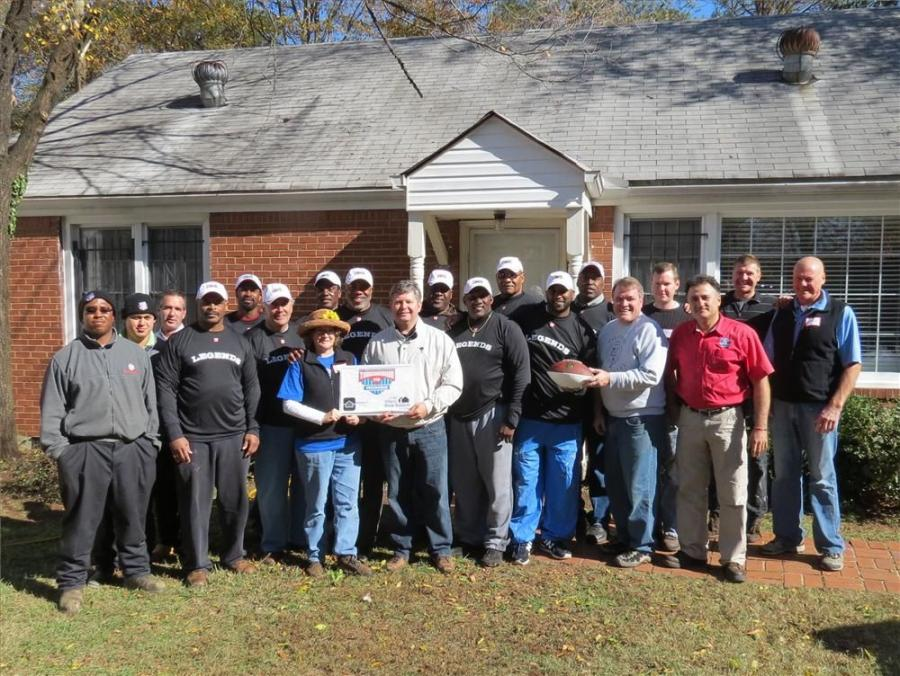More than 20 former NFL players and members of the home building community volunteered to help the Decatur Cooperative Ministry refresh a home for temporarily homeless families as part of HomeAid Care Day and the Touchdown for Homes program.