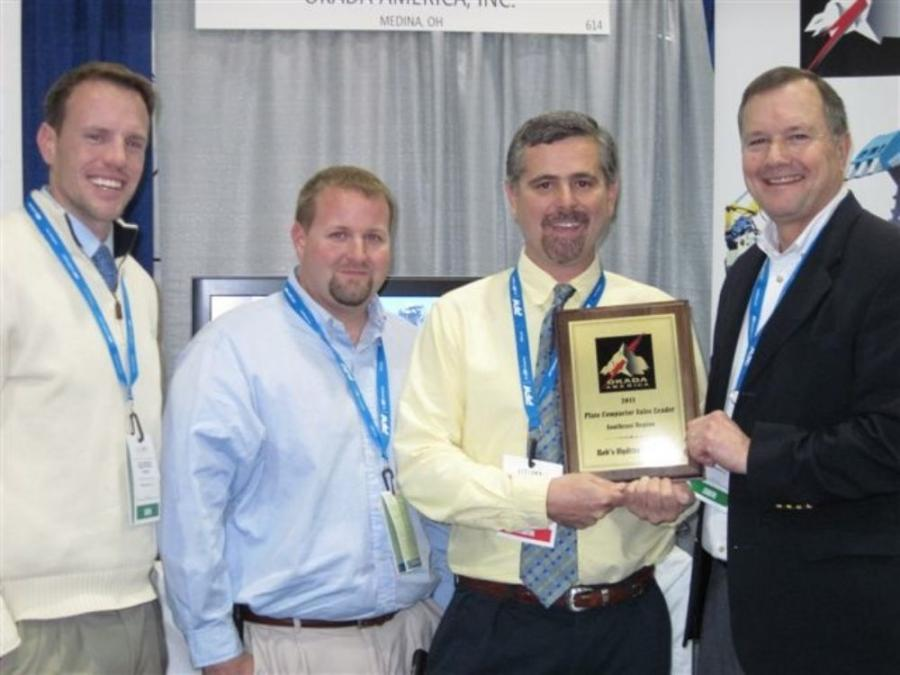 (L-R) are Geordie Stewart, Okada America regional sales manager; Jason Wainright, sales manager of Rob's Hydraulics; Rob Lynch, president of Rob's Hydraulics (accepting the award); and Tony Neikirk, vice president sales of Okada America.
