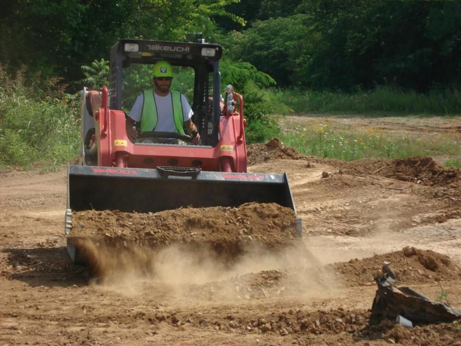 Jeremy Keen of Oscar Stooksbury Contractors in Knoxville tests out the Takeuchi TL8 compact track loader.