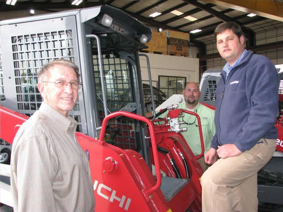 (L-R): Larry Bonds of Bonds Company Inc., Burnsville, Miss., talks with Power Equipment Company's David Hicks and Chad Roberts about a Takeuchi TL10.