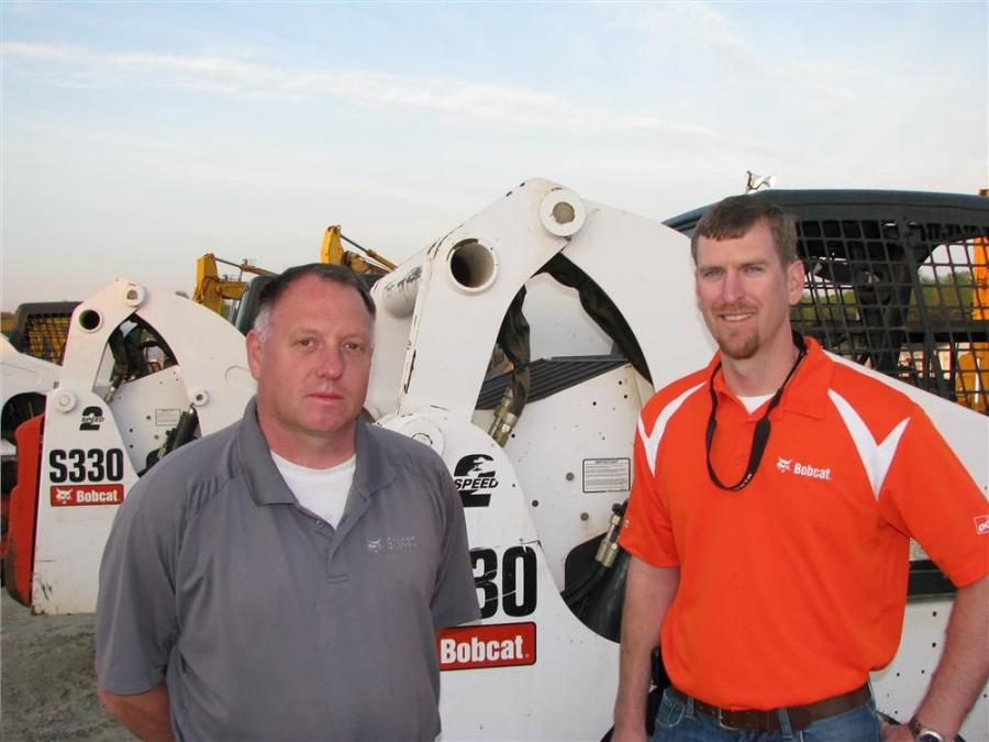 Local Bobcat representatives, Tim Feldman (L), and Matt Cochran, both of Bobcat of Atlanta turned out to monitor the current auction pricing of skid steer loaders.