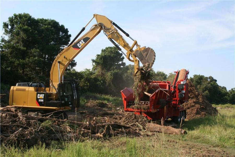 Gary Otter Construction uses a Cat 320E to feed its Wood Hog.