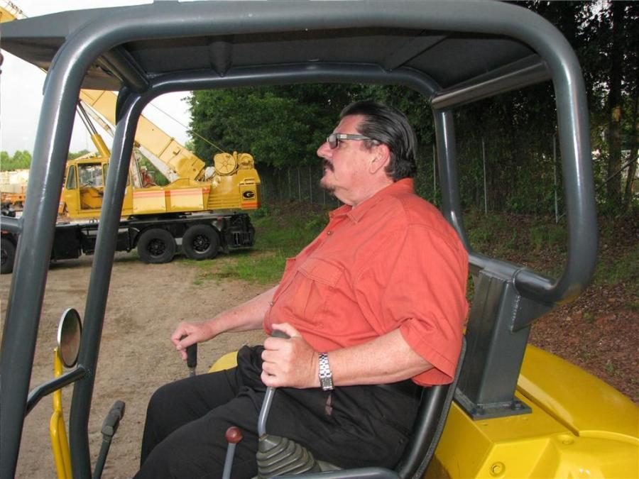 Gary Stone of Lashley Tractor Sales in Lithonia, Ga., tests the Komatsu PC35R mini-excavator.