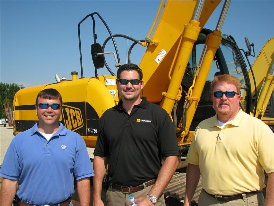 Several JCB excavators were of interest to the guys from the Savannah and Kennesaw locations of JCB of Georgia including (L-R) Chris Shea, Adam Sharpe and Wes Williams.