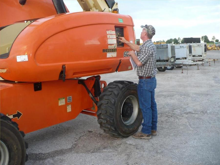 Mike Ray of Tico Machine in Brooksville, Fla., inspects this JLG 600.