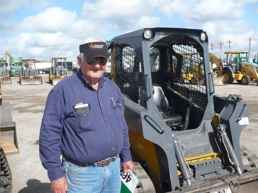 Robert Waler of Lakeland, Fla., gives these track loaders a long look.