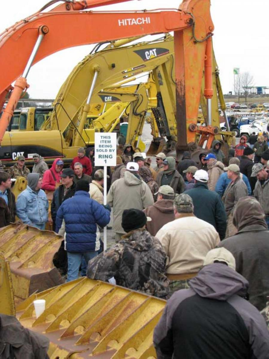When the excavators went on the auction block, bidders quickly gathered around.