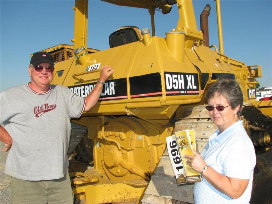 Taking a good look at the dozers including this Cat D5H XL are independent contractor, Philip Ballard and his wife Jeanetta, Utica, Ky.