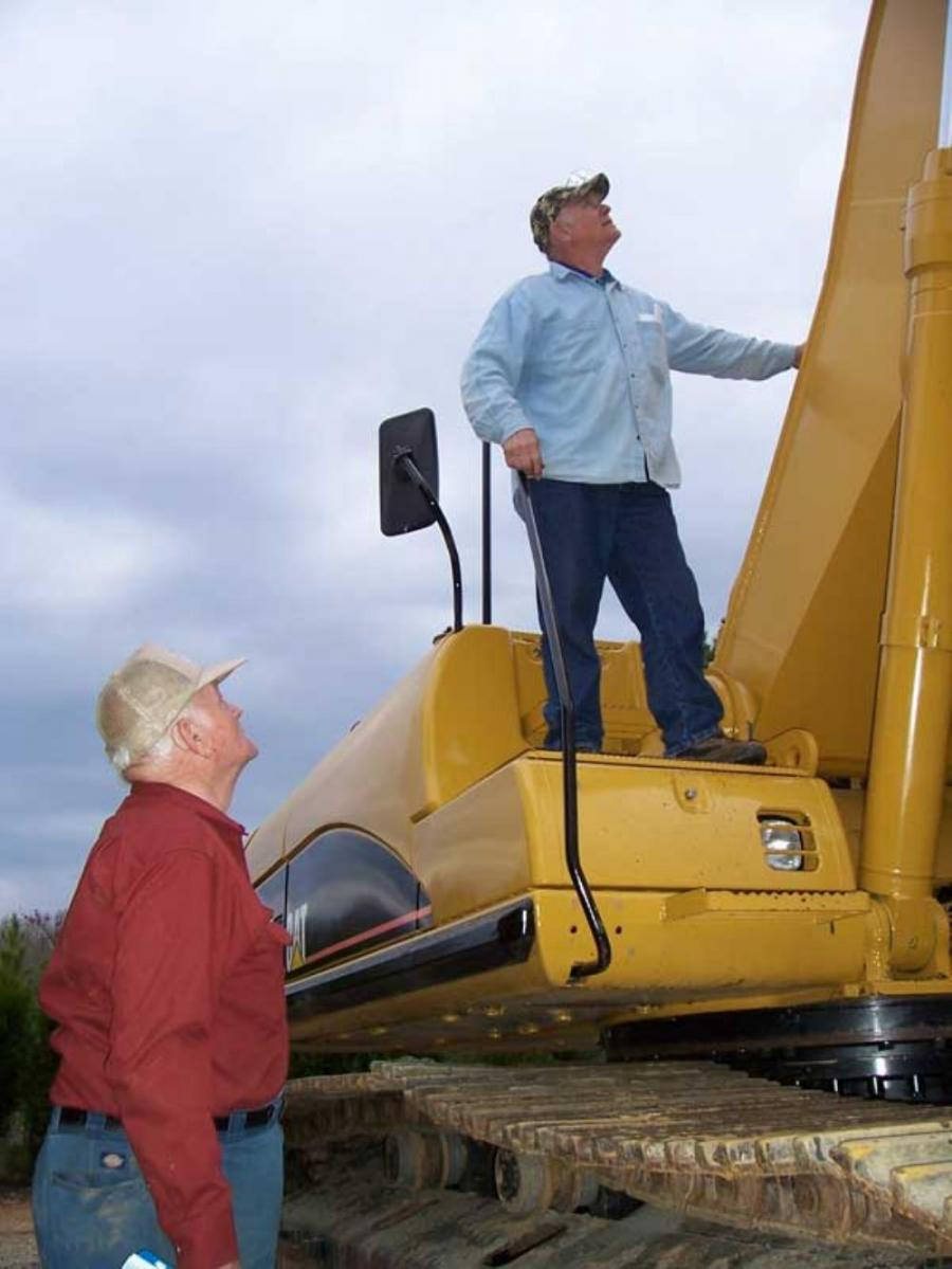 Taking a good look at the boom of a Cat 330CL excavator are Jerry (L) and Art Eckert of Conn-E Construction, Dellton, Pa.