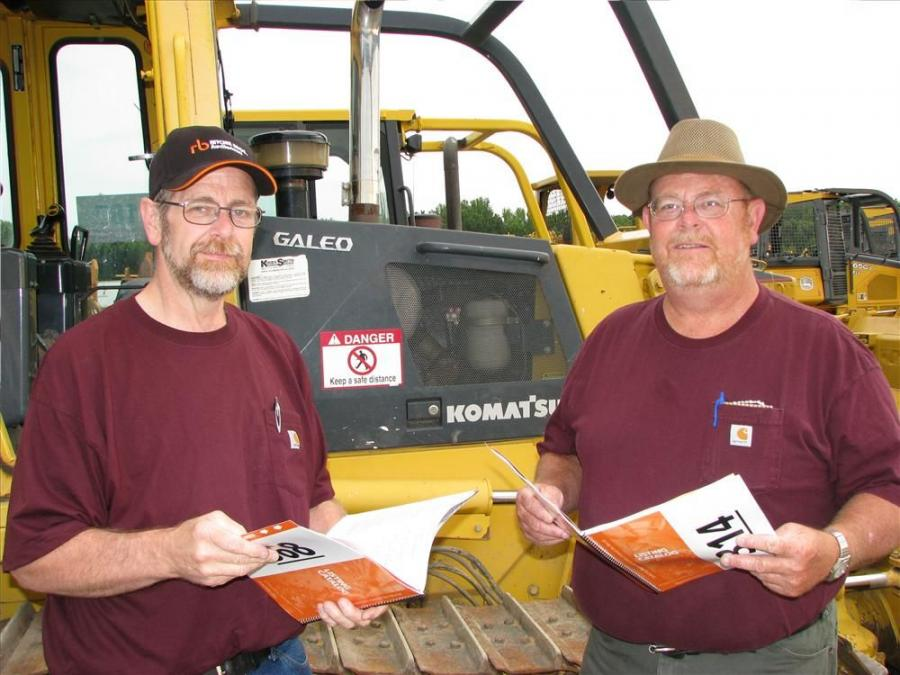Looking at their catalogues for more info on a Komatsu D39EX dozer are Rick Callihan (L), and Bob Callihan, Callihan Grading, Blue Ridge, Ga.
