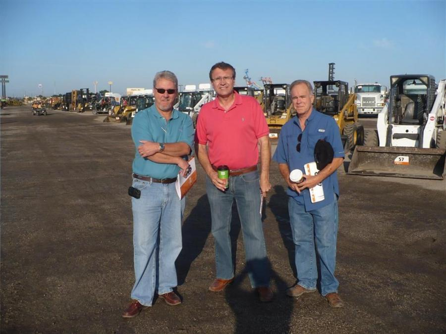 (L-R): Rick Kingsland of Bobcat of Orlando, Steve Halliwell of MasTec and Mike Pursifull of Aquip Inc. talk before the auction begins.
