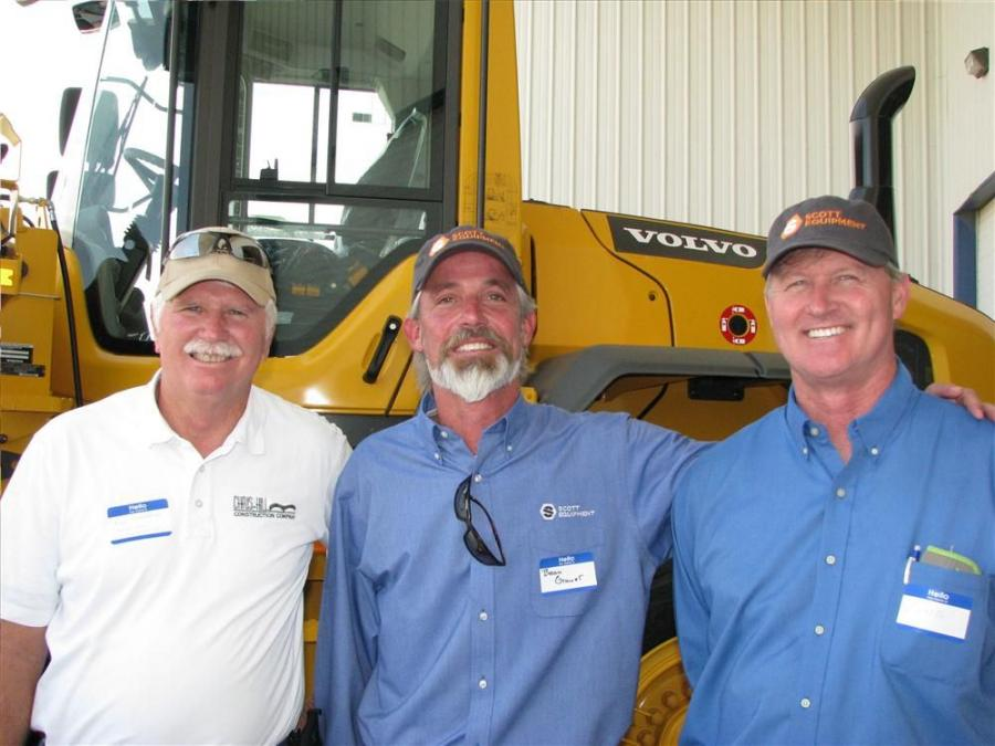 (L-R): Ron Sheppard of Chris-Hill Construction Company, Memphis, Tenn.; Beau Grauer, sales representative of Scott Equipment; and Craig Christenbury, Chris-Hill Construction, Memphis, Tenn., talk about the various Volvo machines on display.