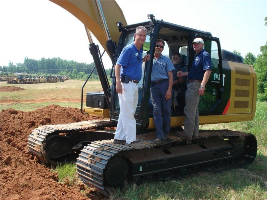 The Trimble GCS 900 3D GPS system equipped on this Cat 320EL excavator was pre-programmed with the dimensions for digging a retention pond. Explaining how the system works and its benefits are Mitch Christenbury (L) of Carolina CAT and Randy Rohrer (R) of