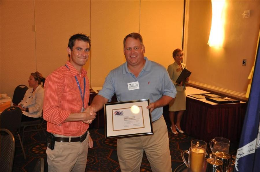Daniel Erwin (L), director corporate safety and risk management, Southern Industrial Constructors, receives the STEP Platinum Award from Tom Headlee, vice president, Watson Electrical, chairman of the board, ABC of the Carolinas.