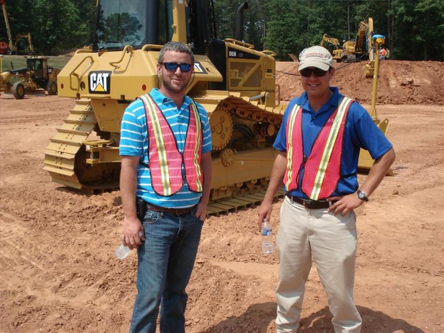 Jeremy Smith (L), Allen Grading, Goldsboro, N.C., and Sean Frizelle, Spectra I.S., go over the Cat AccuGrade/Trimble GCS900 dual antenna system on the Cat D5K.