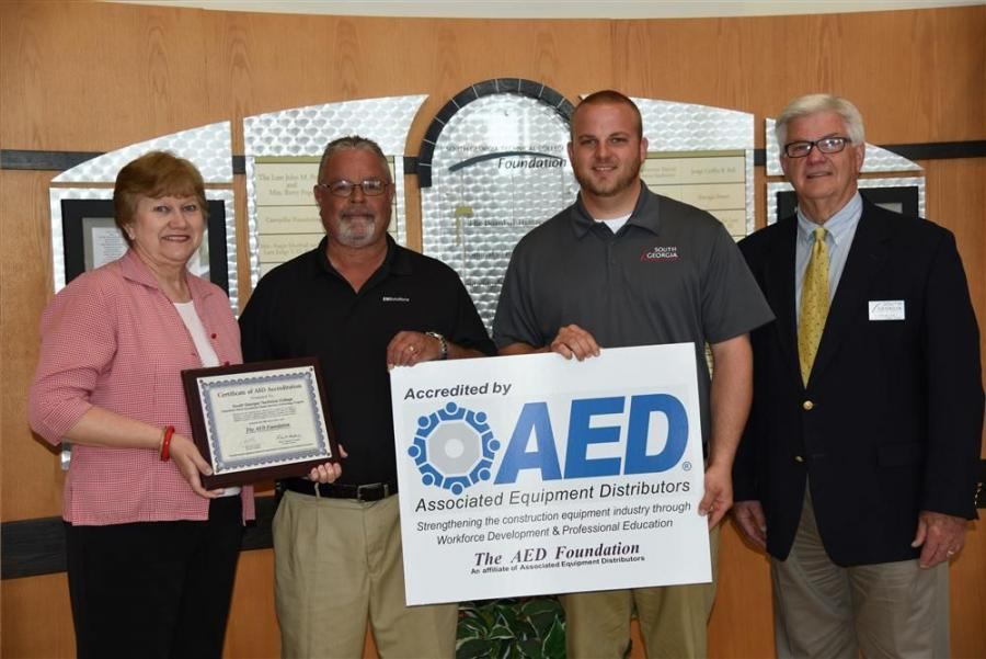 (L-R): Janice Davis, South Georgia Technical College vice president of administrative service, congratulates Rick Davis and Kyle Hartsfield, South Georgia Technical College's Caterpillar heavy equipment dealer service technology instructors, on rece