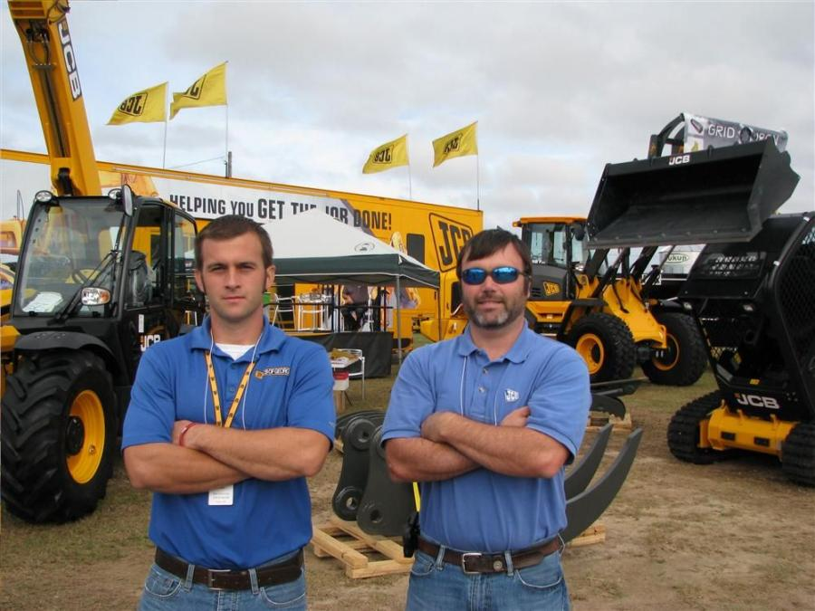 "Clint Holcombe (L) of JCB of Georgia and Chris Shea of Grid-Iron Aftermarket in Pooler, Ga., are ready for the next wave of expo attendees to visit the JCB ""mobile lounge."""