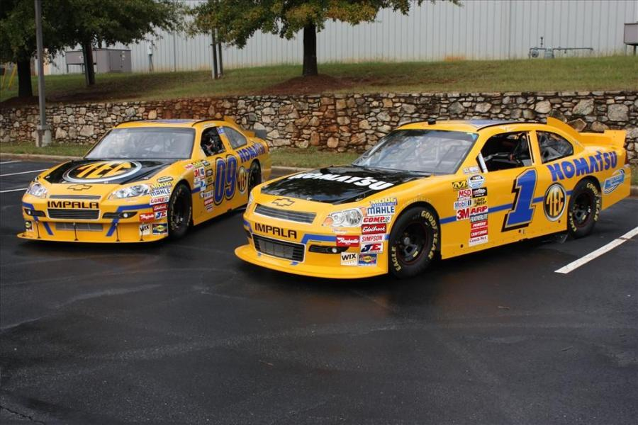 The number 09 Komatsu America-Tractor & Equipment Company car that will be driven by Bobby Labonte in the Amp Energy Juice 500 at Talladega Superspeedway in the Oct. 31 NASCAR Sprint Cup race sits beside the number 1 Komatsu car that was driven by Ryan Ne