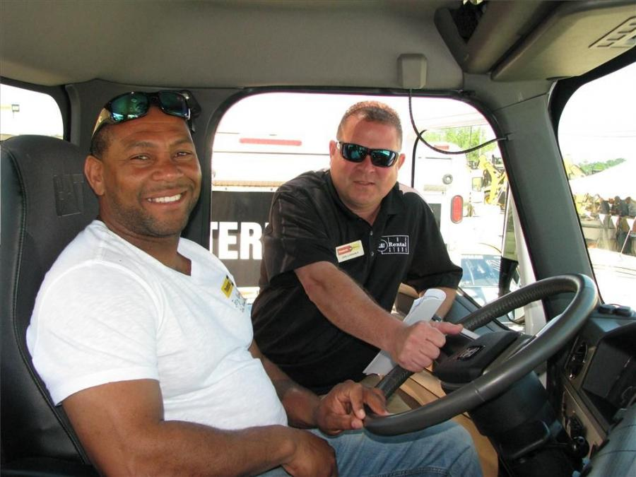 Jerry Woods (L), John Woods Construction, Selma, Ala., and his Thompson CAT rental store representative, Joe Lindsey, talk about the Cat CT660 vocational truck on display.