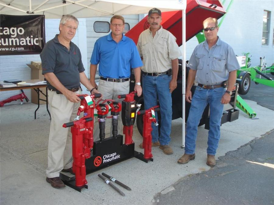 (L-R): Rob Rose and Frank Jolley, both of Chicago Pneumatic, go over the 60 and 90 lb. (27.2 and 40.8 kg) hammers with Martin Brinkman and Richard Marshall, both of Connex Communications Inc. in Denton, N.C.