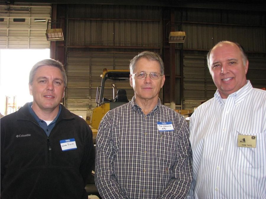Getting ready to make their way through the food line are (L-R) Wade Pierce and Tom Browne of Alabama Power; and Tom Tate, Warrior Tractor.