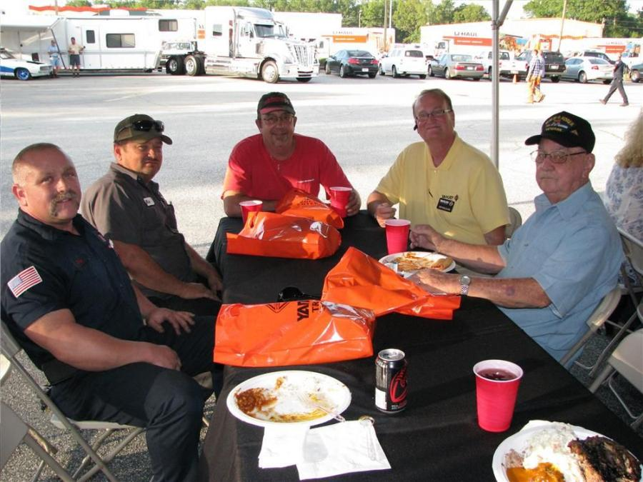 A bit of post dinner chat among local Columbus, Ga., area trucking and recovery professionals (L-R) included Joey Davis of Red Classic Transit; Rick Davis and Mike Koepsell of Columbus Towing & Recovery; Tim Williams, Yancey Truck Centers; and Bill Quick