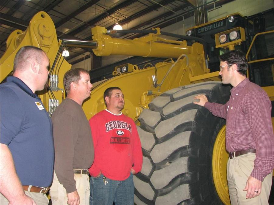 Chris Jones (far L) and Yancey's Scott Chapman (far R) discuss a Cat certified rebuild on 988G wheel loader with Lloyd Shapard and Dustin Sanders of L&L Designs, Griffin, Ga.