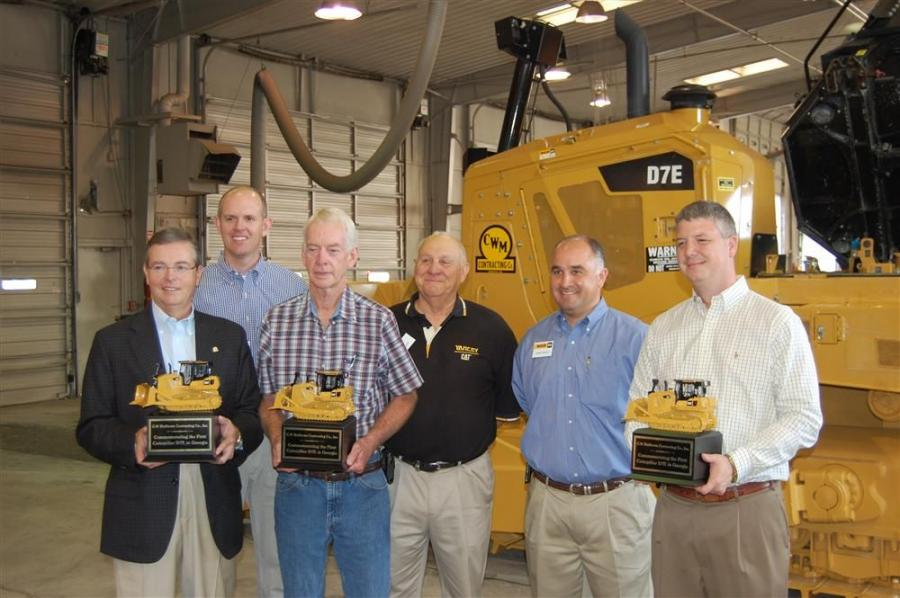 Representatives of Yancey Bros. Co. and Caterpillar Inc. presented mounted models of the new Cat D7E dozer to key members of the staff at C.W. Matthews Contracting Co. Inc. (L-R) are Bill Hammack Jr., C.W. Matthews Contracting; David Nicoll, Caterpillar I