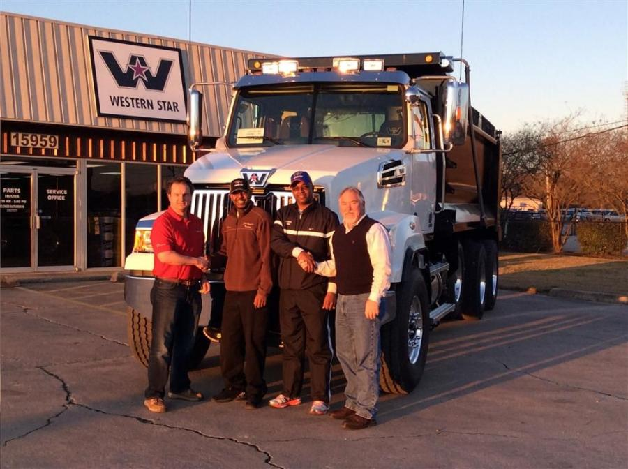 Scott Culotta (L), owner and CEO, and Dwayne Pitre (R), truck manager, both of All Truck Parts & Equipment, sold the company's first Western Star tri-axle dump to J.H. Sanders and his son.
