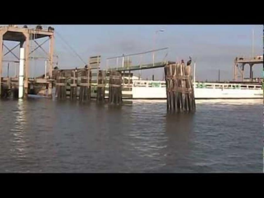 Boats and barges traveling the Intracoastal Waterway radio an operator in the bridge tower, who then stops traffic and slowly swings the bridge open to the east. Image courtesy of YouTube.