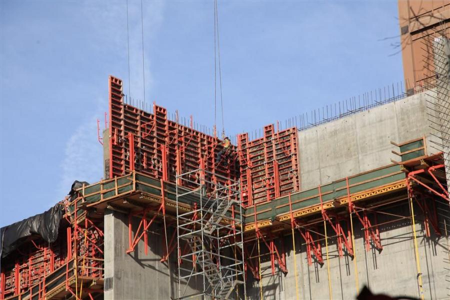 As of the beginning of January 2015 crews were working on the cast-in-place concrete walls, in particular the six-story north wall, which is about 65 ft. (19.8 m) high.