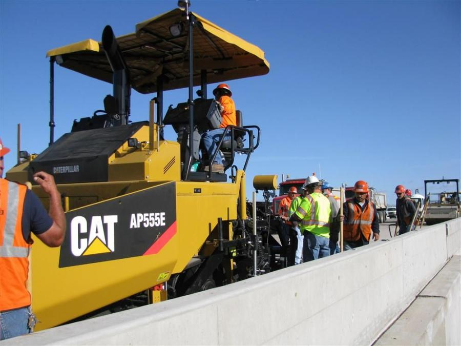 The CKC paving crew uses a Cat AP555E on the U.S. 191 portion of its paving operation.