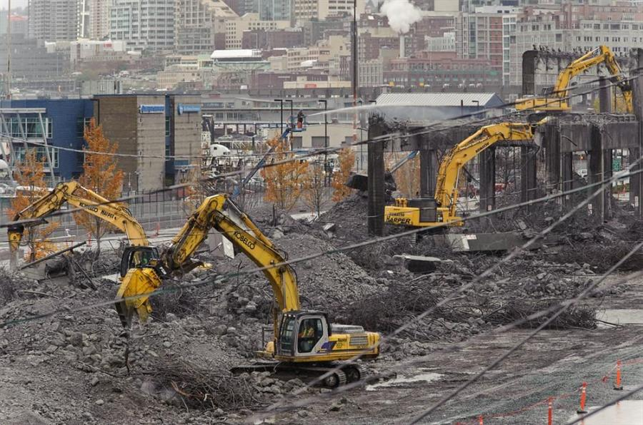 Demolition machines work last November, 2011, making the last 1,100 ft. (335 m) of the south end of the viaduct disappear.