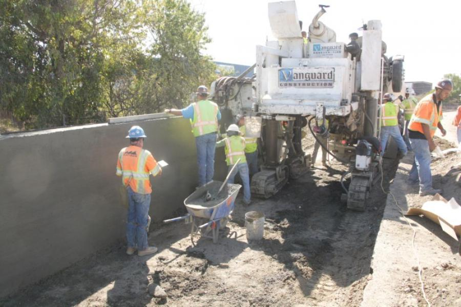 Crews used approximately 7,000 cu. yds. (5,352 cu m) of concrete for the HOV lanes and the retaining wall.