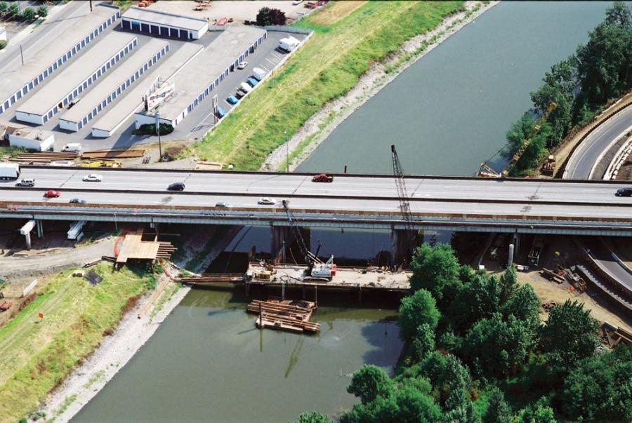 An aerial view of the work bridge with cranes in place.