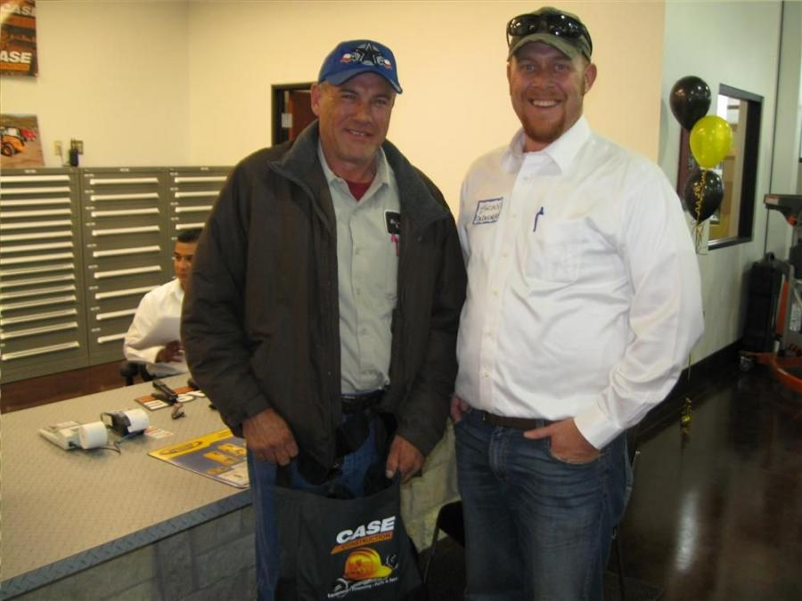 Darrell Goodwin (L) of McLennon County visits with Brian DeDecker in the new parts department capabilities.