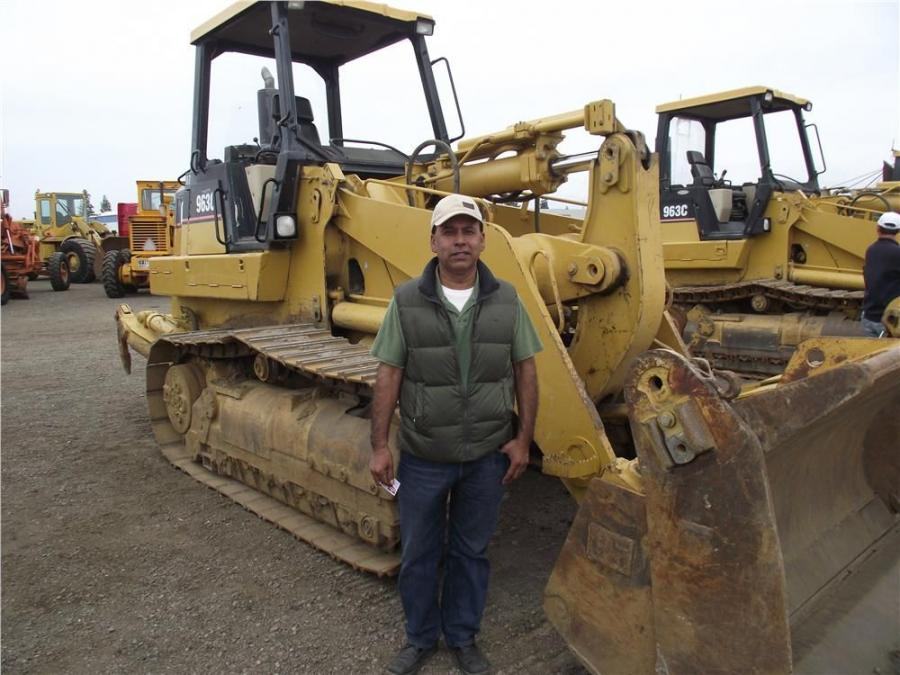 Arturo Flores of San Martin, Calif., is happy he'll be taking this Cat 963C crawler loader home with him.