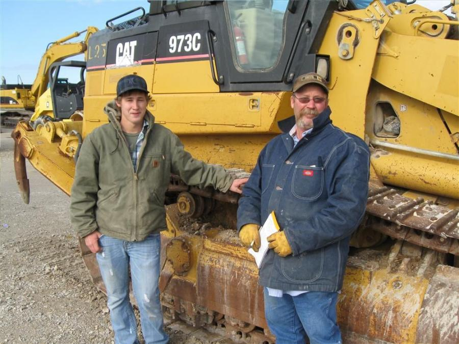 Marshall (L) and Billy Whaley of B&J Tractor, Del Rio, Texas, have a definite interest in this Cat 973 C track loader.