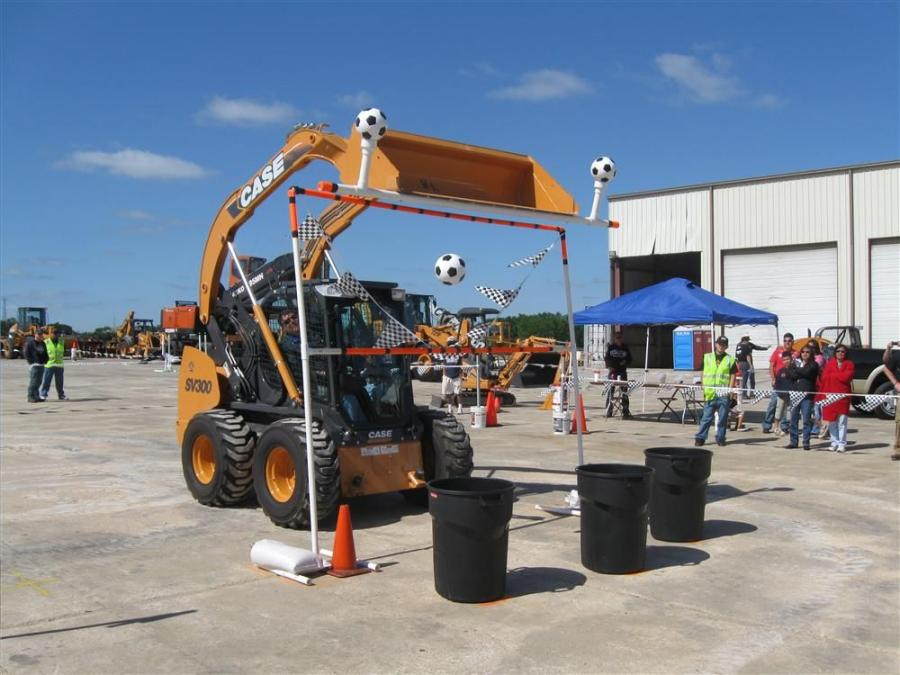 Clay Griffith of Southland Contractors, Fort Worth, Texas, maneuvers the course with a Case SV300 skid steer without losing any soccer balls, while trying to drop them in assigned containers.