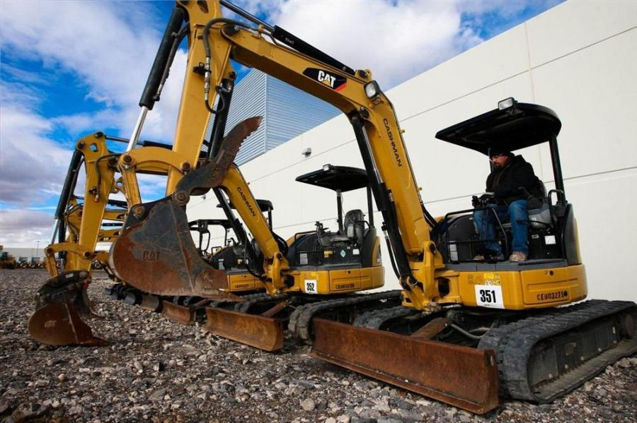 Brian Reed of R.L. Reed Inc. tests out a Cat mini-excavator.