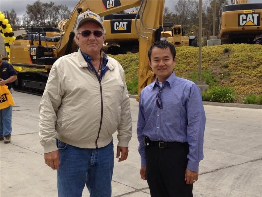 Jim Bostick (L) of JB Bostick Co. speaks with David W. Jin of Cat Truck Sales during the preview event.