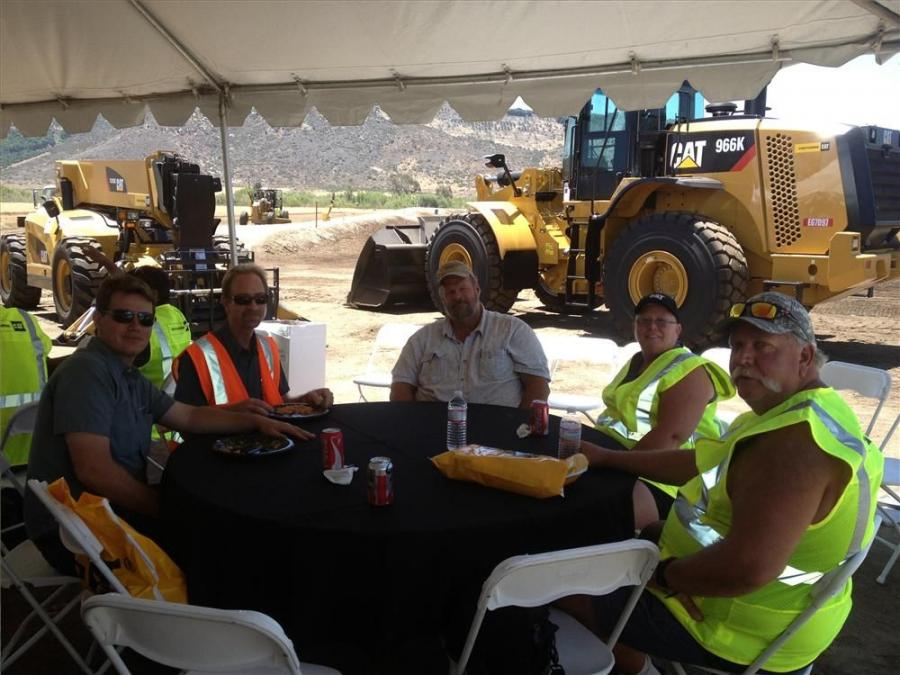 (L-R): Kevin McLin and Craig Anderson, both of San Pascual Valley Soils; and Steve Dowle, Karen Dowle, and Justin Burkard, all of Dowle Agri, enjoy the lunch provided for them at the demo event.