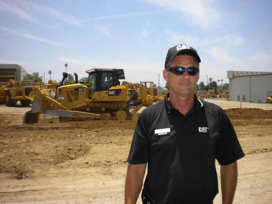 Bob Powers of Caterpillar stands with the CAT D7E.