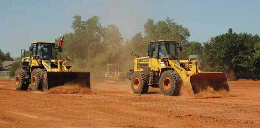 T.J. Campbell Construction Co. puts two of its wheel loaders, a WA380 and a WA320, to work at Cherokee Crossing, a job site in northwest Oklahoma City.