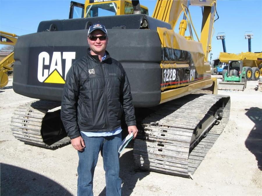 Joe Panebianco of Midcountry Exchange in Syracuse, N.Y., must have brought the cold weather with him to look at this Cat 322 BL excavator.