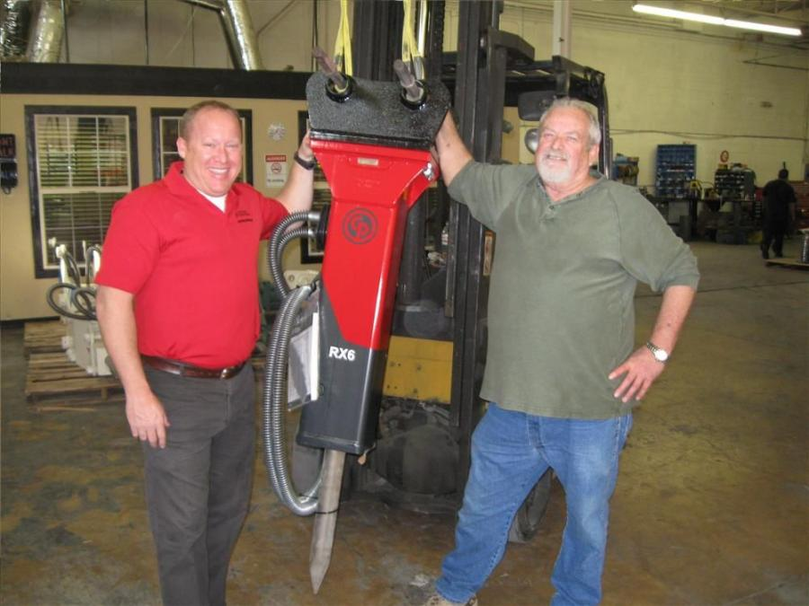 Paul McClendon (L), regional sales manager of Chicago Pneumatic, congratulates David Spainhour, general  manager of Midco Demolition Tool Co., in Dallas, Texas, for becoming a new Chicago Pneumatic dealer.